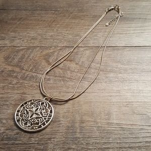 Large round pendant on double snake chain